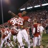 Oklahoma\'s Danzel Williams (23) and Brandon Young (38) leap at the conclusion of the Bedlam college football game in which the University of Oklahoma Sooners (OU) defeated the Oklahoma State University Cowboys (OSU) 51-48 in overtime at Gaylord Family-Oklahoma Memorial Stadium in Norman, Okla., Saturday, Nov. 24, 2012. Photo by Steve Sisney, The Oklahoman
