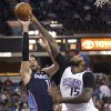 Charlotte Bobcats forward Josh McRoberts (11) shoots over Sacramento Kings defender DeMarcus Cousins (15) during the first half of an NBA basketball game in Sacramento, Calif., on Saturday, Jan. 4, 2014. (AP Photo/Steve Yeater)