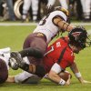 Texas Tech quarterback Seth Doege (7) dives into the end zone under Minnesota\'s Michael Carter for a touchdown during the second quarter of the Meineke Car Care Bowl NCAA college football game, Friday, Dec. 28, 2012, in Houston. (AP Photo/Dave Einsel)