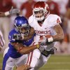 Oklahoma\'s Kenny Stills (4) makes a reception in front of Kansas\' Bradley McDougald (24) during the college football game between the University of Oklahoma Sooners (OU) and the University of Kansas Jayhawks (KU) on Saturday, Oct. 15, 2011. in Lawrence, Kan. Photo by Chris Landsberger, The Oklahoman