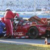 Photo - Rescue workers remove driver Memo Gidley from his car after he was involved in a crash during the IMSA Series Rolex 24 hour sports car race at Daytona International Speedway in Daytona Beach, Fla., Saturday, Jan. 25, 2014. (AP Photo/Dow Graham)