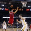 Los Angeles Clippers\' Blake Griffin (32) goes up for a dunk next to Golden State Warriors\' David Lee, right, as Klay Thompson (11) watches during the first half of an NBA basketball game in Oakland, Calif., Monday, Jan. 21, 2013. (AP Photo/Marcio Jose Sanchez)
