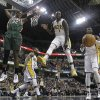 Photo - Milwaukee Bucks' Khris Middleton (22), Indiana Pacers' Lance Stephenson (1) and Indiana Pacers' Roy Hibbert watch as a ball goes out-of-bounds during the first half of an NBA basketball game on Thursday, Feb. 27, 2014, in Indianapolis. (AP Photo/Darron Cummings)