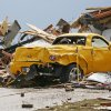 Hugh Harrell walks through debris near his 2005 Chevy SSR at the house of his daughter, Kaci Harrell, 14708 S. Broadway, in Oklahoma City on Tuesday, May 21, 2013, after a tornado struck south Oklahoma City and Moore, Okla., on Monday. Hugh Harrell had the car parked in his daughter\'s garage to protect it from hail. Photo by Nate Billings, The Oklahoman