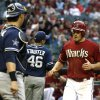 Photo - Arizona Diamondbacks center fielder A.J. Pollock, right, scores in the first inning during a baseball game against the San Diego Padres, Wednesday, May 28, 2014, in Phoenix. (AP Photo/Rick Scuteri)