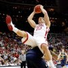 OU\'s Blake Griffin lands on Michigan\'s Manny Harris during a second-round men\'s NCAA college basketball tournament game between Oklahoma and Michigan in Kansas City, Mo., Saturday, March 21, 2009. PHOTO BY BRYAN TERRY, THE OKLAHOMAN