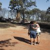 The Grigg family hug as they gather on 132nd Street and see for the first time the damage from Friday\'s wildfire on Saturday, Aug. 4, 2012, in Slaughterville, Okla. Photo by Steve Sisney, The Oklahoman