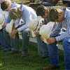 Rough stock cowboys lower there head in prayer before the start of competition during the second day of the International Finals Youth Rodeo at the Shawnee Expo Center on Tuesday, July 15, 2008, in Shawnee, Okla. Staff Photo By CHRIS LANDSBERGER
