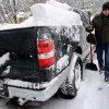 David Paluch brushes off snow from his truck in front of his home in Barrington, Ill., Thursday, Jan. 2, 2014. The New Year\'s Day snow storm stretched into Thursday for parts of Illinois, bringing double-digit snow totals to the suburbs of Chicago. (AP Photo/Daily Herald, Bob Chwedyk) MANDATORY CREDIT; MAGS OUT; TV OUT