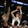 Brooklyn Nets forward Kris Humphries (43) shoots over defending Chicago Bulls players in the first half of an NBA basketball game at the Barclays Center, Friday, Feb. 1, 2013, in New York. (AP Photo/Kathy Willens)