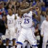 Photo - Kansas guard Elijah Johnson (15) celebrates after a basket during the first half of an NCAA college basketball game against Belmont, Saturday, Dec. 15, 2012, in Lawrence, Kan. (AP Photo/Charlie Riedel) ORG XMIT: KSCR104