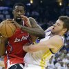 Los Angeles Clippers\' DeAndre Jordan (6) grabs a rebound next to Golden State Warriors\' David Lee during the first half of an NBA basketball game in Oakland, Calif., Wednesday, Jan. 2, 2013. (AP Photo/Marcio Jose Sanchez)