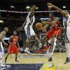 Photo - Atlanta Hawks guard Louis Williams (3) goes to the basket between Memphis Grizzlies guard Tony Allen (9) and forward Rudy Gay (22) in the first half of an NBA basketball game on Saturday, Dec. 8, 2012, in Memphis, Tenn. (AP Photo/Lance Murphey)