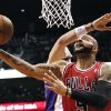 Chicago Bulls\' Carlos Boozer, front, shoots past Phoenix Suns\' Marcin Gortat, of Poland, during the first half of an NBA basketball game, Wednesday, Nov. 14, 2012, in Phoenix. (AP Photo/Ross D. Franklin)