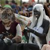 Stefany Belisle, cat, and Cari Elliott, dark elf, wait for their catagory in the costume contest during the Medieval Fair on Saturday, March 31, 2012, in Norman, Okla. Photo by Steve Sisney, The Oklahoman