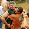 Brian Hill, top, gets a hug from Matt Ligon after their team scored a point during the MUDD (Mankind United to Destroy Dystrophy) Volleyball Tournament to benefit the Muscular Dystrophy Association, in Mustang, Okla., Saturday, July 19, 2014. Photo by Nate Billings, The Oklahoman
