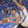 Denver\'s Danilo Gallinari (8) drives past Oklahoma City\'s Thabo Sefolosha (2) during the first round NBA playoff game between the Oklahoma City Thunder and the Denver Nuggets on Sunday, April 17, 2011, in Oklahoma City, Okla. Photo by Chris Landsberger, The Oklahoman