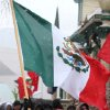 A marcher carries a Mexico flag as protesters brave the cold and snow as they march from the Capitol to a park in Denver on Wednesday, May 1, 2013. About 200 people gathered at the Capitol for immigration reform. The May Day rallies carry a special sense of urgency this year, two weeks after a bipartisan group of senators introduced a bill that would bring many of the estimated 11 million living in the U.S. illegally out of the shadows. Colorado\'s rally comes just after the governor signed a bill allowing students in the country illegally to pay in-state tuition at state colleges and universities, ending a 10-year political battle.(AP Photo/Ed Andrieski)