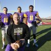 Photo - Anadarko football coach Kent Jackson poses with Brandon Pollard, left, R.J. Sink & Mykel Shaw in Yukon, Tuesday December 3, 2013. Photo By Steve Gooch, The Oklahoman