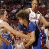 Oklahoma\'s Whitney Hand (25) and Nicole Griffin (4) fight Monica Engelman (13) for control of the ball during the women\'s college basketball game between the Oklahoma Sooners and the Kansas Jayhawks at the LLoyd Noble Center in Norman, Okla., Sunday, March, 4, 2011. Photo by Sarah Phipps, The Oklahoman