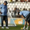Photo - Team physical therapist Walter Ferreira, left, looks at Uruguay's Luis Suarez, right, during a training session at Jacare Stadium in Sete Lagoas, Brazil, Tuesday, June 10, 2014. Uruguay's team continues their preparations for the upcoming 2014 World Cup. (AP Photo/Victor R. Caivano)