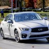 Formula One driver Sebastian Vettel gives test rides in a new Infiniti Q50 to employees at Nissan Motor Co.\'s North American headquarters in Franklin, Tenn., on Wednesday, Nov. 13, 2013. (AP Photo/Erik Schelzig)