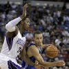 Photo -   Golden State Warriors guard Stephen Curry, right, drives to the basket against Sacramento Kings forward Jason Thompson during the first quarter of an NBA preseason basketball game in Sacramento, Calif., Wednesday, Oct. 17, 2012. (AP Photo/Rich Pedroncelli)