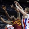 Photo - Cleveland Cavaliers forward Alonzo Gee looses the ball against Detroit Pistons guard Kyle Singler, right, during the first half of an NBA basketball game Wednesday, Feb. 12, 2014, in Auburn Hills, Mich. (AP Photo/Duane Burleson)