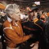Texas head coach Mack Brown, left, talks with OSU head coach Mike Gundy after the college football game between the Oklahoma State University Cowboys (OSU) and the University of Texas Longhorns (UT) at Boone Pickens Stadium in Stillwater, Okla., Saturday, Oct. 31, 2009. Texas won, 41-14. Photo by Nate Billings, The Oklahoman