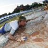 Rick Alexander slides underneath rope and through chocolate pudding attempting to collect balloons during the UCO Homecoming kickoff at the University of Central Oklahoma in Edmond, Okla., on Sunday, September 16, 2007. By James Plumlee The Oklahoman.