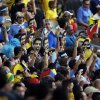 Photo - Uruguay fans holds masks with the face of banned Uruguayan player Luis Suarez prior to the World Cup round of 16 soccer match between Colombia and Uruguay at the Maracana Stadium in Rio de Janeiro, Brazil, Saturday, June 28, 2014. (AP Photo/Themba Hadebe)