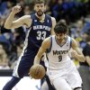 Minnesota Timberwolves\' Ricky Rubio, right, of Spain, reaches the loose ball in time to beat Memphis Grizzlies\' Marc Gasol, also of Spain, to the ball in the first quarter of an NBA basketball game on Saturday, March 30, 2013, in Minneapolis. (AP Photo/Jim Mone)