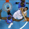 New Orleans Hornets forward Ryan Anderson (33) is blocked as he goes to the basket by Oklahoma City Thunder forward Serge Ibaka (9) and center Kendrick Perkins, top, in the first half of an NBA basketball game in New Orleans, Saturday, Dec. 1, 2012. (AP Photo/Gerald Herbert)