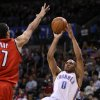 OKLAHOMA CITY THUNDER / PORTLAND TRAIL BLAZERS / NBA BASKETBALL Oklahoma City\'s Russell Westbrook shoots a fallaway jumper over Portland\'s Brandon Roy during the Thunder - Portland game April 3, 2009 in the Ford Center in Oklahoma City. BY HUGH SCOTT, THE OKLAHOMAN ORG XMIT: KOD