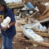 Susan Sleeper recovers one of her favorite items out of her destroyed home west of El Reno, Wednesday, May 25, 2011. Photo by Chris Landsberger, The Oklahoman