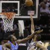 San Antonio Spurs\' Tim Duncan, rifght, is hit in the face by Oklahoma Thunder\'s Serge Ibaka, left, as he shoots during the third quarter of an NBA basketball game, Thursday, Nov. 1, 2012, in San Antonio. (AP Photo/Eric Gay) ORG XMIT: TXEG113