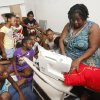 Children watch as Angela Lewis sews a pillow during a children\'s summer camp at the Divine Wisdom Worship Center in Midwest City, OK, Thursday, July 19, 2012, By Paul Hellstern, The Oklahoman