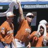 Photo - Players in the Texas dugout celebrate after Ben Johnson scored against Vanderbilt in the first inning of an NCAA baseball College World Series game in Omaha, Neb., Friday, June 20, 2014. (AP Photo/Nati Harnik)