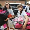 Students help a new arrival unload personal belongings from her car as she moves into Methodist Hall on Tuesday at Oklahoma City University. Photo by Jim Beckel, The Oklahoman. Jim Beckel - THE OKLAHOMAN