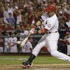 Photo - St. Louis Cardinals' Carlos Beltran hits a two-run scoring double during the third inning of Game 1 of the National League baseball championship series against the Los Angeles Dodgers Friday, Oct. 11, 2013, in St. Louis. (AP Photo/David J. Phillip)