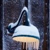 Snowfall came to an end Friday night and many Oklahomans spent time Saturday, Jan. 30, 2010, clearing snow and ice from their vehicles, driveways and sidewalks. Icicles cling to an exterior lamp at a Midwest City restaurant. Photo by Jim Beckel, The Oklahoman