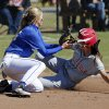 Hilldale\'s Sarah Hughey is safe at third beating the tag of Zoe Rayner as Bethel plays Hilldale in the State 4A Softball Championship game on Saturday, Oct. 19, 2013 in Shawnee, Okla. Photo by Steve Sisney, The Oklahoman