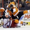 Philadelphia Flyers\' Tom Sestito (32) collides with New York Rangers\' Jeff Halpern (15) during the first period of an NHL hockey game, Thursday, Jan. 24, 2013, in Philadelphia. (AP Photo/Matt Slocum)