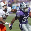 Why Kansas State will win 2. OU hasn\'t faced a rushing attack like K-State\'s: Kansas State rushers have averaged 5.9 yards a carry through three games, and Oklahoma\'s run defense has shown itself to be suspect so far. UTEP\'s Nathan Jeffery gashed the Sooners for 177 yards, and although OU wound up with impressive numbers vs. Florida A&M, the Rattlers did break off a couple nice runs early. Senior DT Casey Walker\'s return could help, but how much of a difference can one guy make? Photo: Miami defensive back Deon Bush, left, catches up with Kansas State running back John Hubert during the first half of a Sept. 8 game in Manhattan, Kan. (AP Photo/Orlin Wagner)