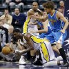 Indiana Pacers\' Roy Hibbert, bottom left, makes a pass while being defended by New Orleans Hornets\' Robin Lopez (15) during the first half of an NBA basketball game, Wednesday, Nov. 21, 2012, in Indianapolis. (AP Photo/Darron Cummings)