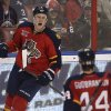 Photo - Florida Panthers' Dylan Olsen (4) celebrates with Erik Gudbranson (44) after he scored a goal against the Winnipeg Jets during the second period of a NHL hockey game in Sunrise, Fla., Thursday, Dec. 5, 2013. (AP Photo/J Pat Carter)