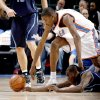 Oklahoma City\'s Kevin Durant gets the loose ball over Utah\'s Ronnie Brewer during the NBA basketball game between the Oklahoma City Thunder and the Utah Jazz at the Ford Center in Oklahoma City, Wednesday, Jan. 14, 2009. PHOTO BY BRYAN TERRY, THE OKLAHOMAN