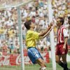 Photo - FILE - In this July 4, 1994 file photo, Brazilian forwards Bebeto, centre, and Romario, right, celebrate Bebeto's match-winning goal, during the World Cup second round soccer match against the US, in Stanford Stadium California. Dejected US defender Fernando Clavijo, centre, walks behind the two. On this day: On Independence Day the US was knocked out of the World Cup it was hosting after losing 1-0 to Brazil. (AP Photo/Eric Draper, File)