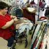 Lisa Eubanks prices clothes at ReRun Junction, a Norman thrift store run by developmentally disabled adults. PHOTO BY STEVE SISNEY, THE OKLAHOMAN
