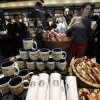 Photo - Journalists tour the first Starbucks the day before its public opening in Bogota, Colombia, Wednesday, July 16, 2014. The three-floor coffee house in Bogota is the first of 50 that the Seattle-based company plans to open here in the next five years. (AP Photo/Fernando Vergara)